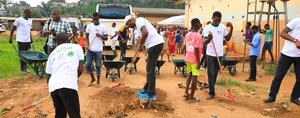 African Development Bank Staff Council and Lion Club clean up flood-hit Ivorian community