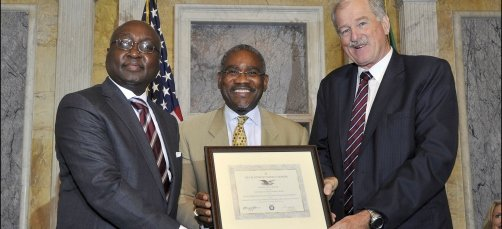 US Congressman Gregory Meeks (centre) presents AfDB President Donald Kaberuka and Carlos Sere, Vice-President of the IFAD, with US Treasury Development Impact Honors for a joint AfDB-IFAD agriculture infrastructure project in Uganda